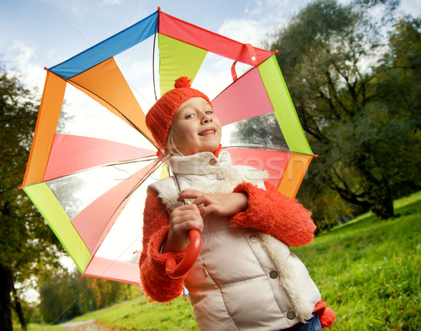 Stock photo: Beautiful little girl with colorful umbrella