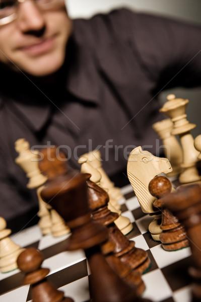Chess master thinking before making a move (shallow Dof, focus o Stock photo © Nejron