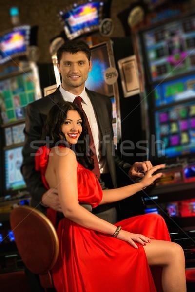 Gyönyörű fiatal pér játékautomata kaszinó nő pénz Stock fotó © Nejron