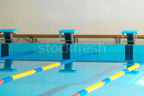 Starting blocks and lanes in a swimming pool  Stock photo © Nejron