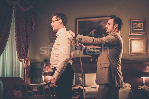 Tailor measuring client for custom made suit tailoring  Stock photo © Nejron