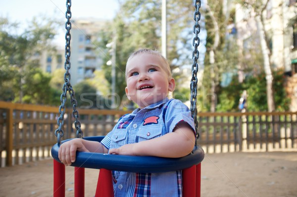 Cute ребенка Swing парка семьи весело Сток-фото © Nejron