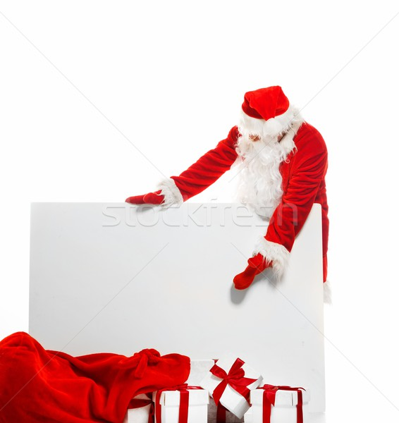Santa Claus with sack full of gift boxes and blank notice board  Stock photo © Nejron