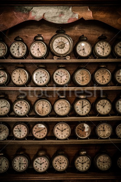 Stock photo: Vintage alarm clocks on a wooden shelf