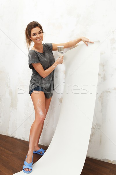 Young beautiful brunette woman brush and wallpaper Stock photo © Nejron