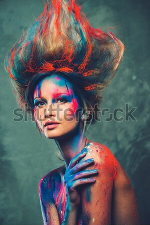 Young woman muse with creative body art and hairdo holding paint brushes  Stock photo © Nejron