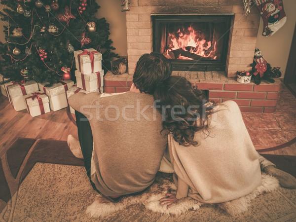 ストックフォト: カップル · 暖炉 · クリスマス · 装飾された · 女性