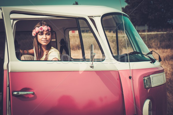 Hippie girl in a minivan on a road trip Stock photo © Nejron