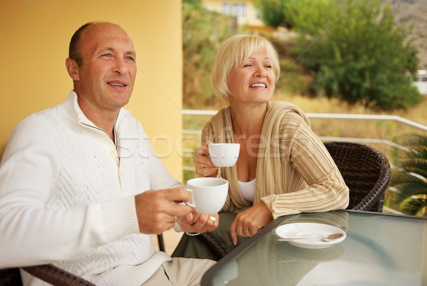 Middle-aged couple drinking caffee outdoors Stock photo © Nejron
