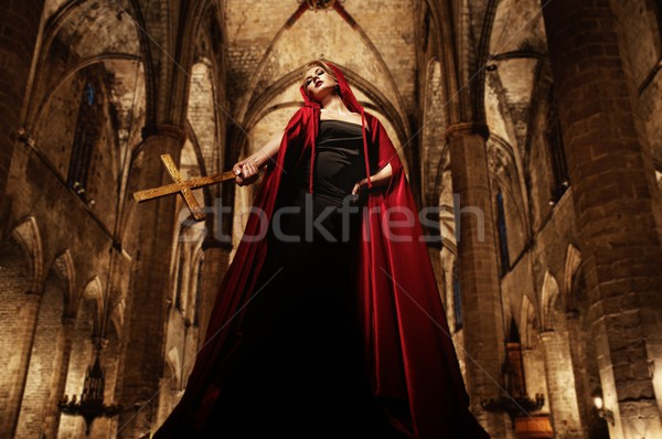 Woman with golden cross inside cathedral Stock photo © Nejron