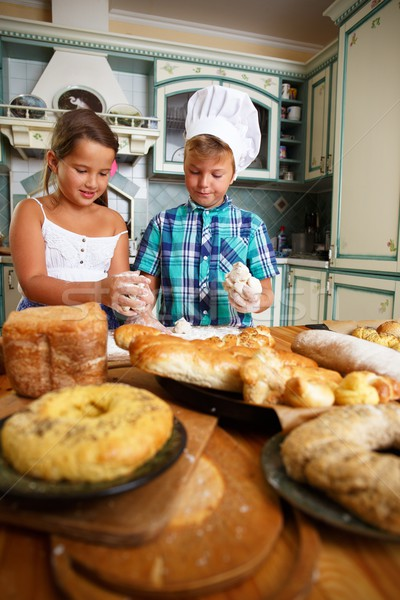 Happy children cooking homemade pastry Stock photo © Nejron