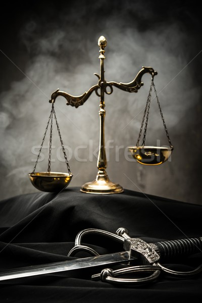 Scales and sword of Justice on a judge's mantle Stock photo © Nejron