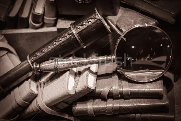 Spyglass and loupe on vintage books Stock photo © Nejron
