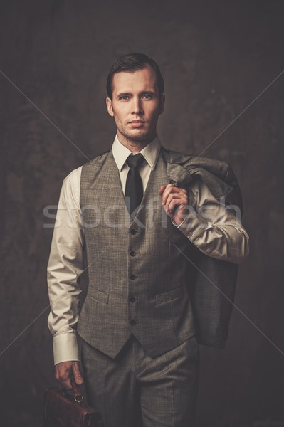 Well-dressed man with jacket over shoulder  Stock photo © Nejron