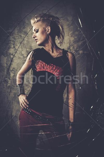 Punk girl behind broken glass  Stock photo © Nejron