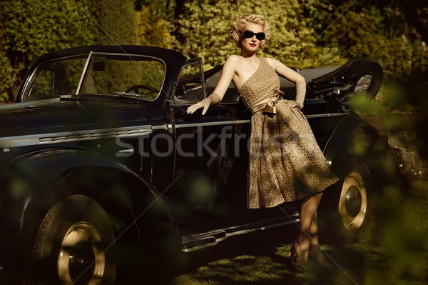 Woman near a retro car outdoors Stock photo © Nejron