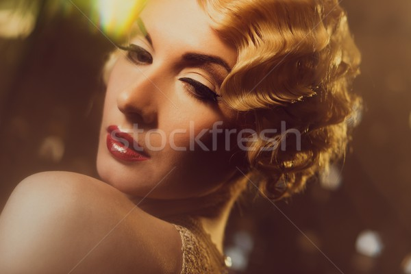 Elegant blond retro woman  in golden dress with beautiful hairdo and red lipstick Stock photo © Nejron