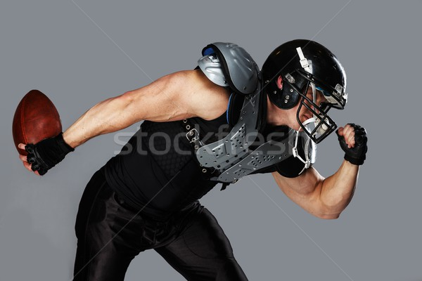 American football player with ball wearing helmet and armour  Stock photo © Nejron