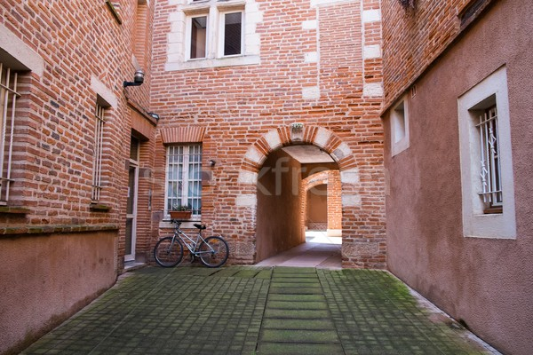 Quiet patio with bicycle in Albi town, France Stock photo © Nejron