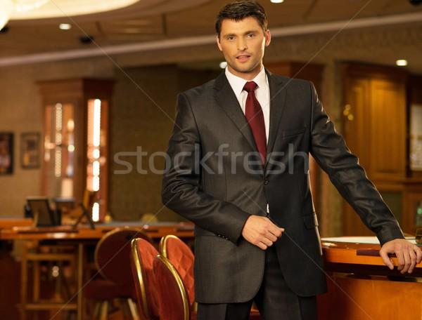 Handsome brunette wearing suit and necktie in luxury interior  Stock photo © Nejron