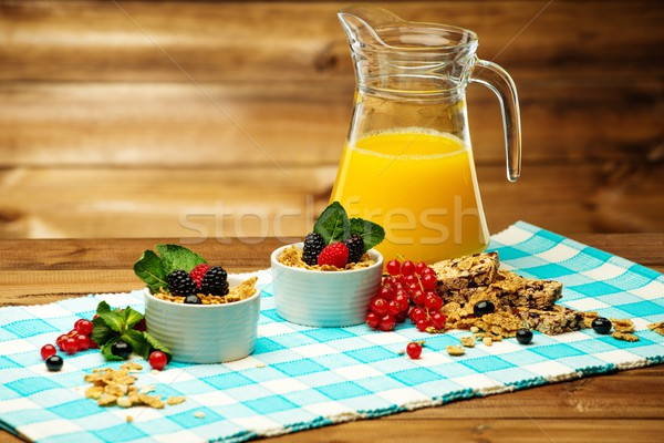 Healthy breakfast with fresh orange juice on tablecloth in wooden rural interior  Stock photo © Nejron