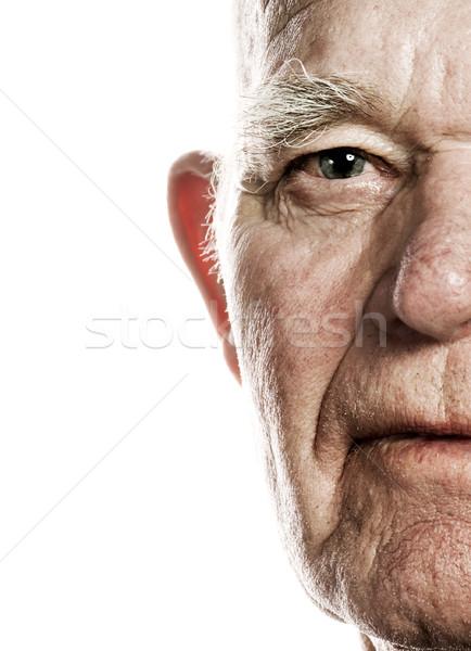 Elderly man's face over white background Stock photo © Nejron