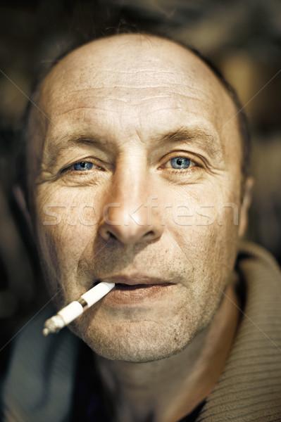 Stock photo: Man with a cigarette close-up portrait