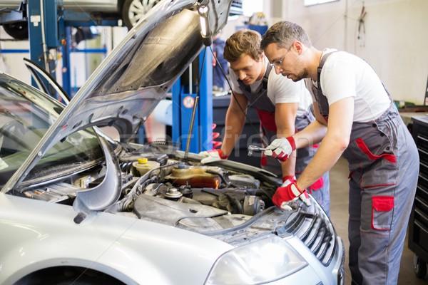 Two mechanics fixing car in a workshop Stock photo © Nejron