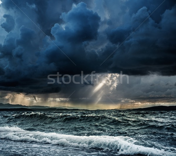 Heavy rain over stormy ocean Stock photo © Nejron