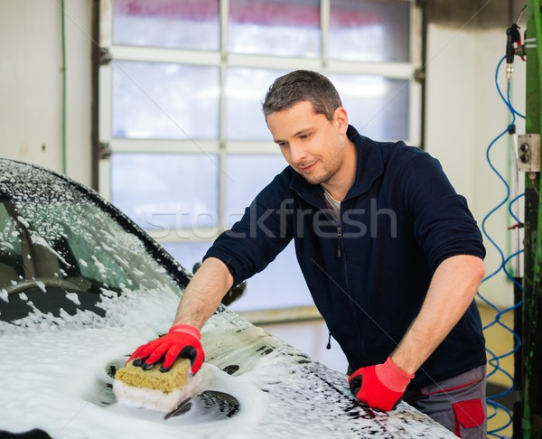 Man worker washing luxury car with sponge on a car wash  Stock photo © Nejron