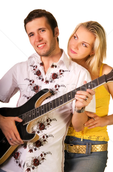 Young musician plays guitar and beautiful blond girl stands near Stock photo © Nejron