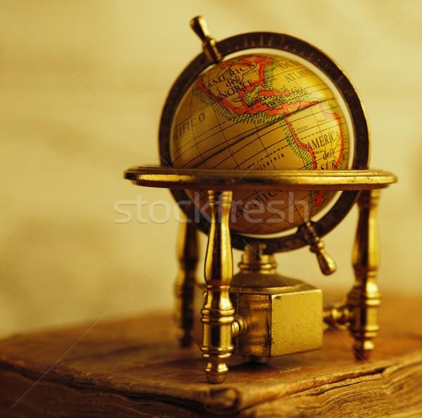 Globe standing on a vintage book. Stock photo © Nejron
