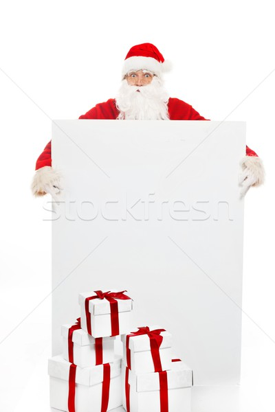 Santa Claus with many gift boxes and blank notice board  Stock photo © Nejron
