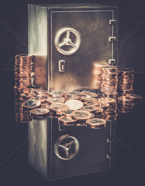 Conceptual little safe with euro coins Stock photo © Nejron