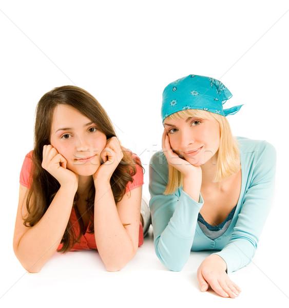 Two pretty teenage girls isolated on white background Stock photo © Nejron