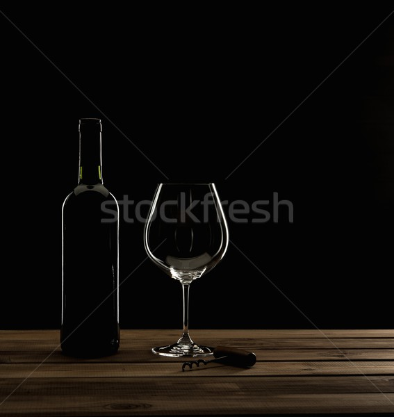 Bottle,glass and corkscrew on a wooden table  Stock photo © Nejron