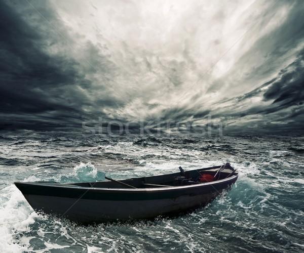 заброшенный лодка бурный морем небе воды Сток-фото © Nejron