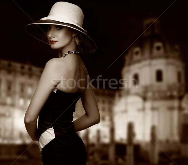 Retro woman against night city. Stock photo © Nejron