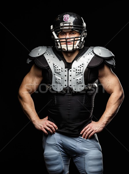 Stock photo: American football player wearing helmet and protective armour