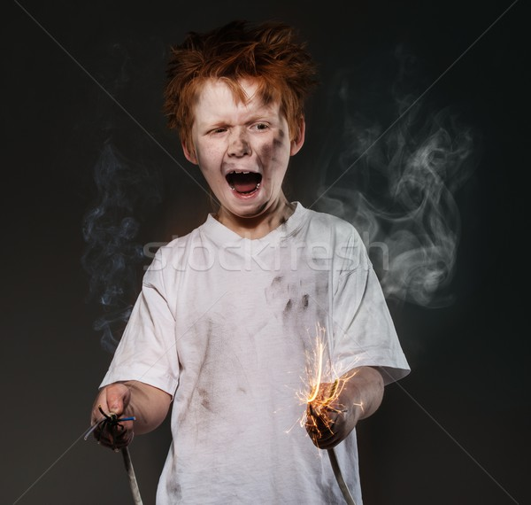 Little redhead bad boy with sparkling wires Stock photo © Nejron