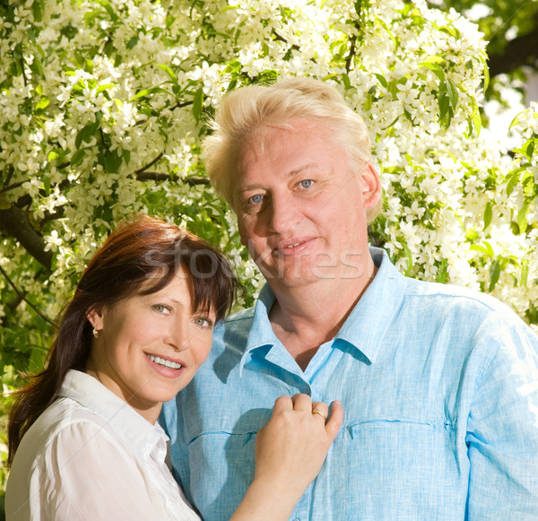 Beautiful middle-aged couple in love outdoors Stock photo © Nejron
