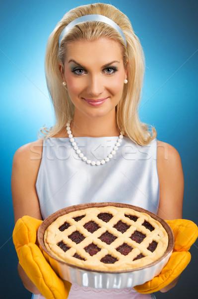 Beautiful woman holding hot italian pie. Retro stylized portrait Stock photo © Nejron