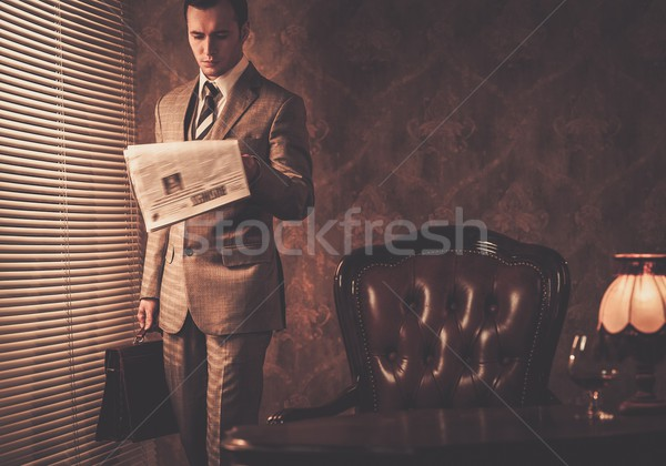 Well-dressed businessman reading newspaper Stock photo © Nejron