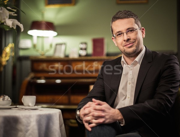 Middle-aged man behind table in luxury vintage style interior  Stock photo © Nejron