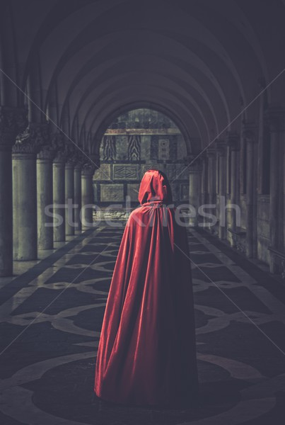 Woman in red cloak walking away Stock photo © Nejron
