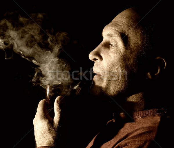 Sepia portrait of a pipe smoker Stock photo © Nejron