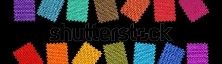 Fabric patterns isolated on black background Stock photo © Nejron