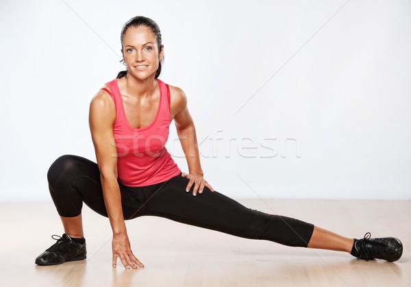 Beautiful athlete woman  doing fitness exercise. Stock photo © Nejron