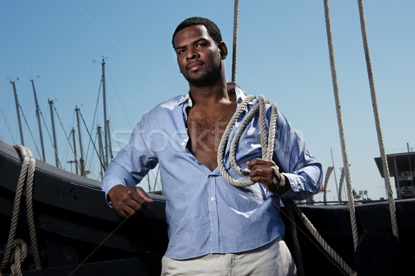 Handsome afro-american sailor against boats. Stock photo © Nejron