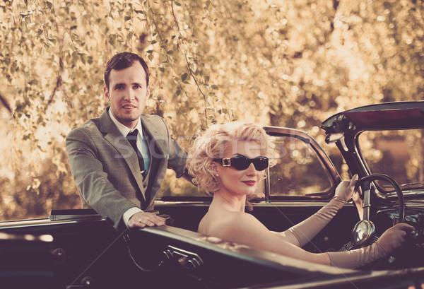 Retro couple and convertible Stock photo © Nejron